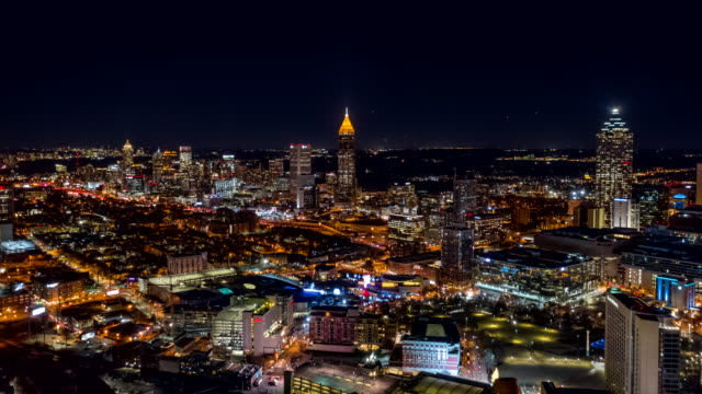 Atlanta Aerial v483 Hyperlapse crossing low to high over downtown at night, picturesque cityscape