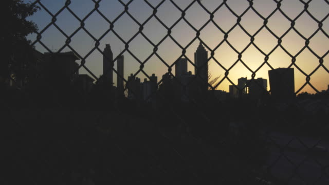 Atlanta City Skyline Panning Right Behind Fence video