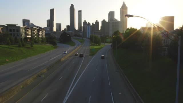 Atlanta City Skyline Tilt Up Sun Setting with Birds video