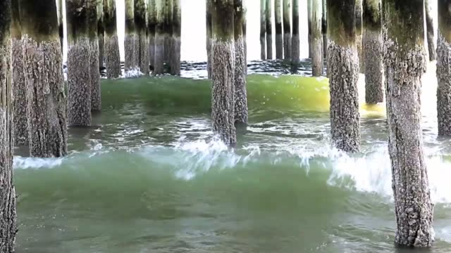 Atlantic Ocean waves rolling under the pier at Old Orchard Beach Maine