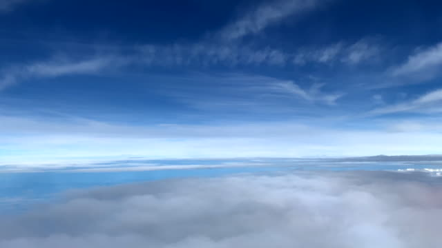 atmospheric blue sky with white clouds