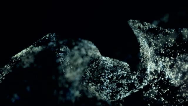 vídeos de stock e filmes b-roll de atmospheric particle dust and powder. - sand