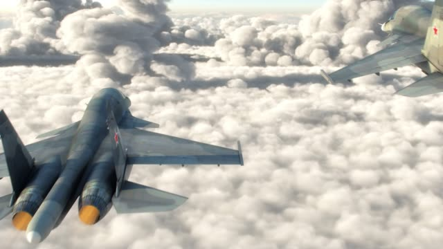Attack aircraft flying above the clouds