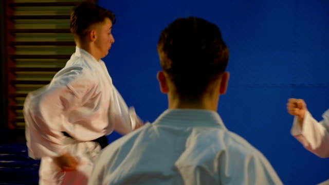Attack karate sequence with spectacular jump towards adversary performed by young fighter at the dojo video