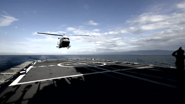Attendant is point the way for military helicopter video