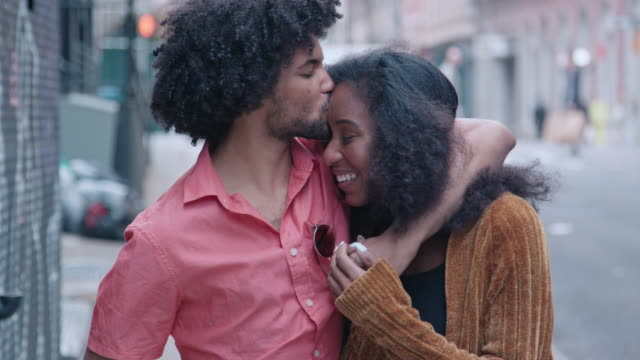 Attractive African American Couple Walk and Show Affection on Urban Street video