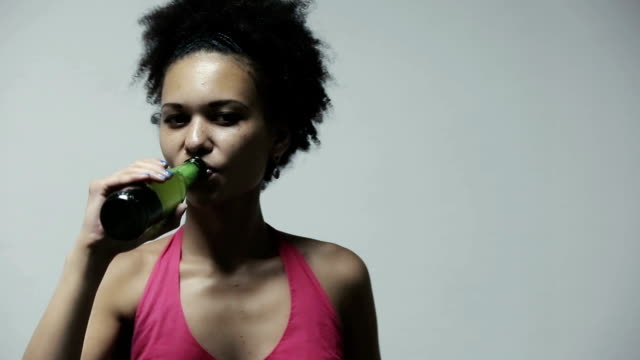 Attractive african american woman drinking beer video