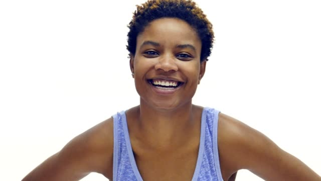 Attractive African American woman smiling - video