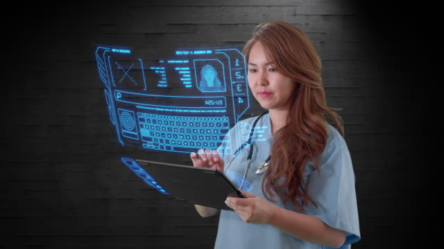 Attractive Asian female doctor uses holographic touchscreen computer device - vídeo