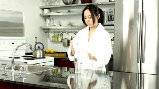 Attractive Asian girl 30s in her kitchen video