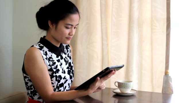 Attractive Asian Woman Enjoying Time In A Cafe video
