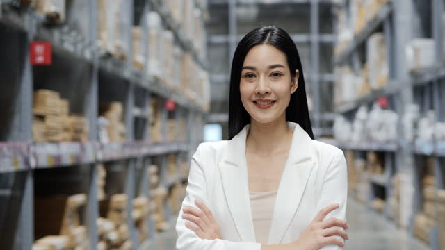 A attractive beautiful young businesswoman with long-hair cross her arm and look into camera.