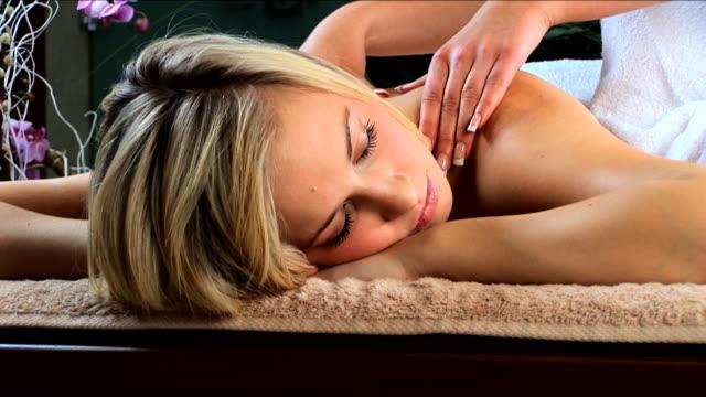 Attractive blonde girl has massage video