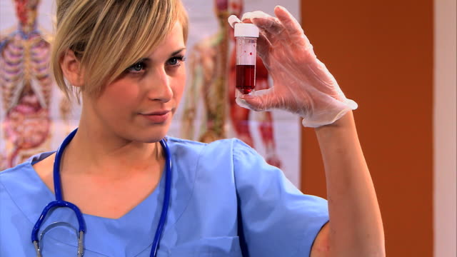 Attractive blonde scrub nurse with blood sample video