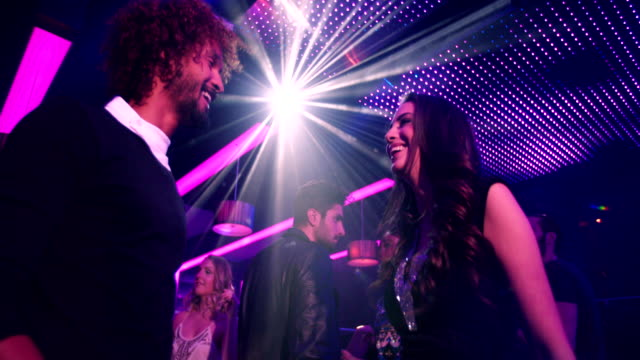 Attractive Brazilian woman smiling and living nightlife at party video