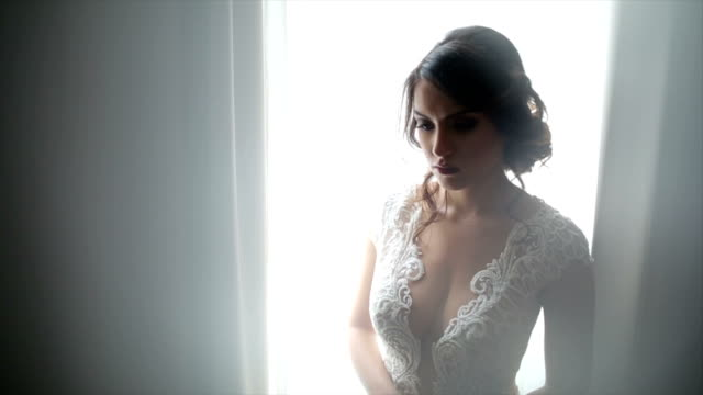 attractive bride posing in her wedding dress - wedding fashion stock videos and b-roll footage