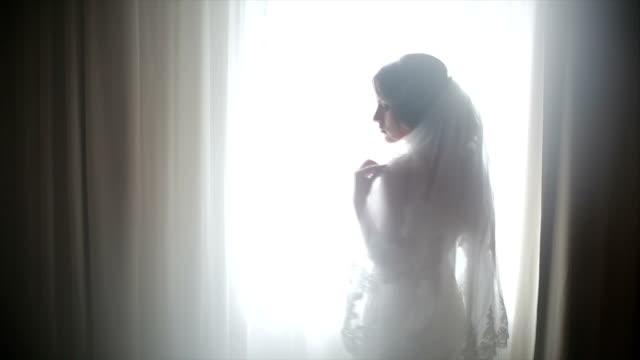 Attractive bride posing in her wedding dress video