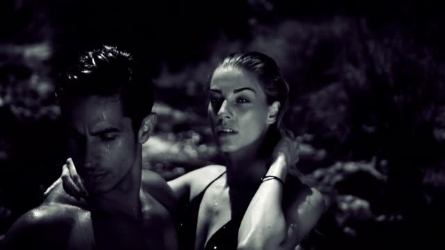 attractive couple on set - modelka i model filmów i materiałów b-roll