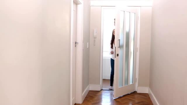 Attractive couple opening the front door video