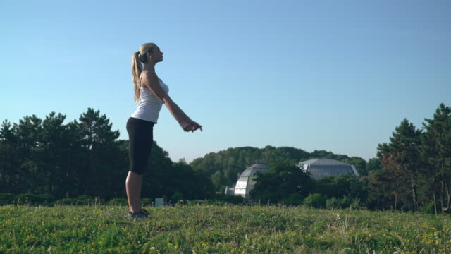 Attractive female enjoy sport routine in the park video