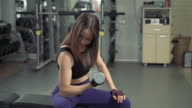 istock Attractive fitness girl practicing exercises with dumbbells in the gym. Young woman lifting weight in sport club 1212242686