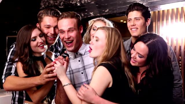 Attractive friends dancing together on the dance floor video