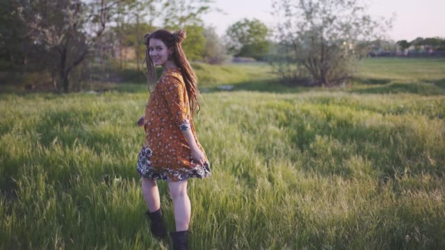 attractive fun hippie woman with dreadlocks in the woods at sunset having good time outdoors - hippie fashion stock videos & royalty-free footage