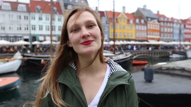 Attractive girl near Nyhavn canal