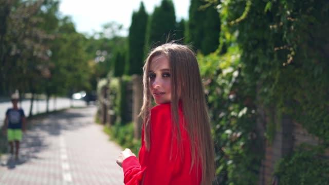 attractive girl outdoors in summer. - длина стоковые видео и кадры b-roll