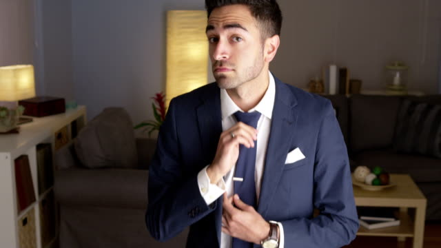Attractive Hispanic man dancing in suit video