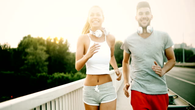 Attractive man and beautiful woman jogging together video