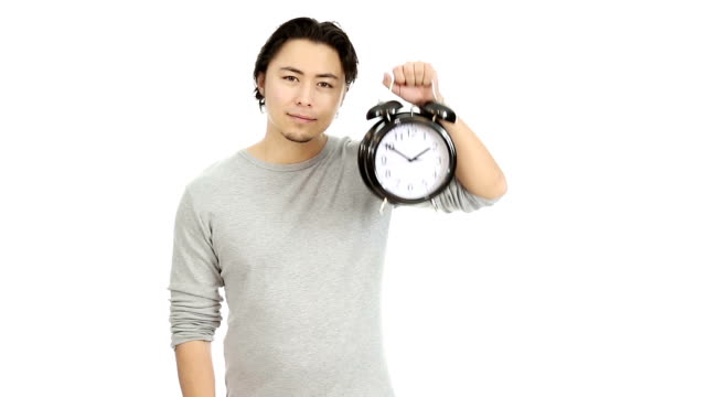 Attractive man holding a clock video