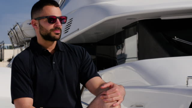 Attractive man on yacht. video