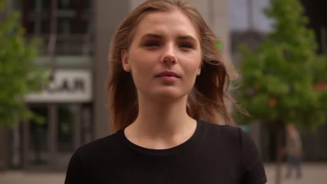 attractive model walks on street - trentenne video stock e b–roll
