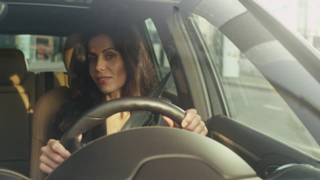 Attractive Smiling Business Woman Driving a Car video