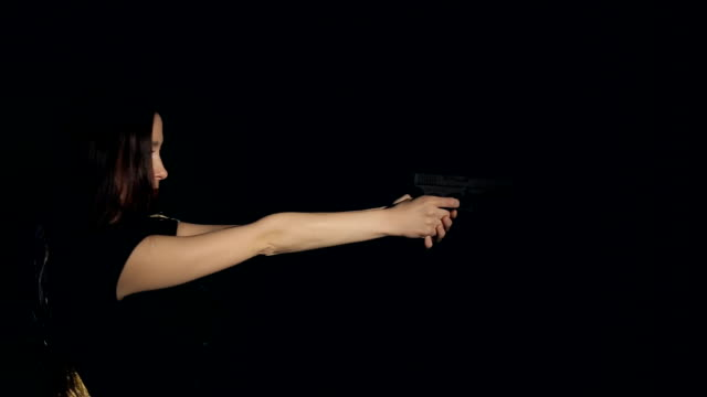 Attractive woman firearms practice laser gun video