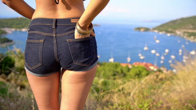 cu attractive woman in hot pants - pantaloncini video stock e b–roll