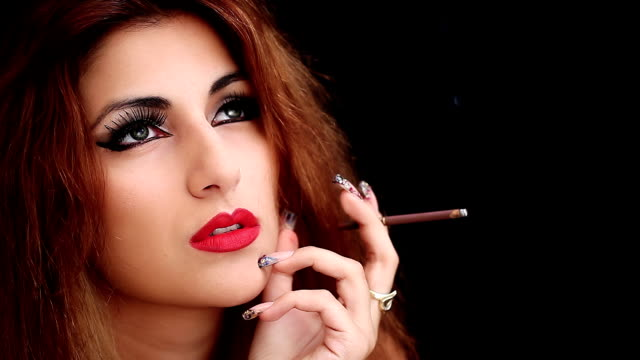 Attractive woman thinks smoking a cigarette video
