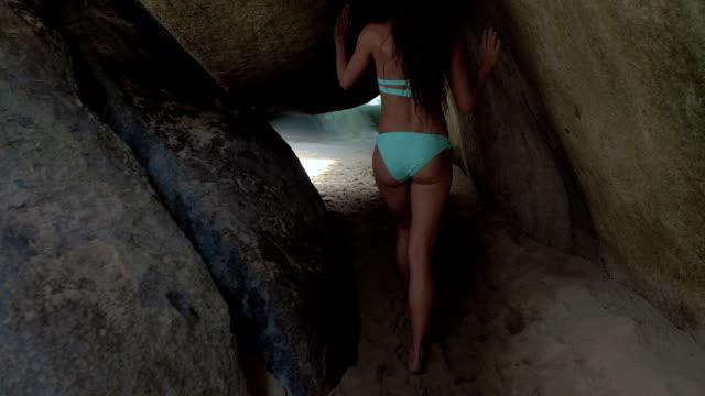 attractive woman walking in the Baths, Virgin Gorda video