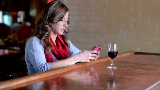 Attractive young professional female texting on her phone