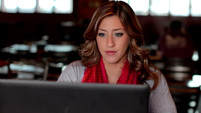 Attractive young professional female using a laptop