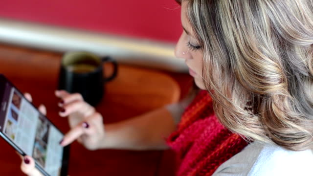 Attractive young professional female using a tablet