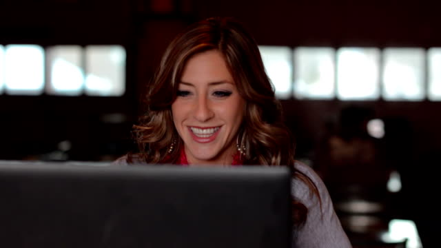 Attractive young professional female using her laptop