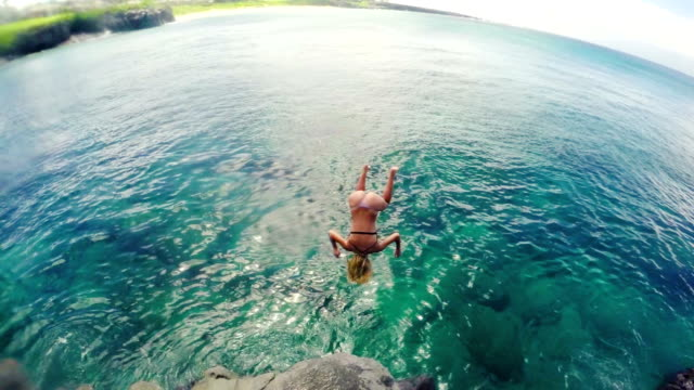 Attractive Young Woman Back Flip Cliff Jump in Bikini into Ocean. Slow Motion. Slow Motion Attractive Young Woman Back Flip Cliff Jump in Bikini into Ocean. Summer Fun Lifestyle. cliff jumping stock videos & royalty-free footage
