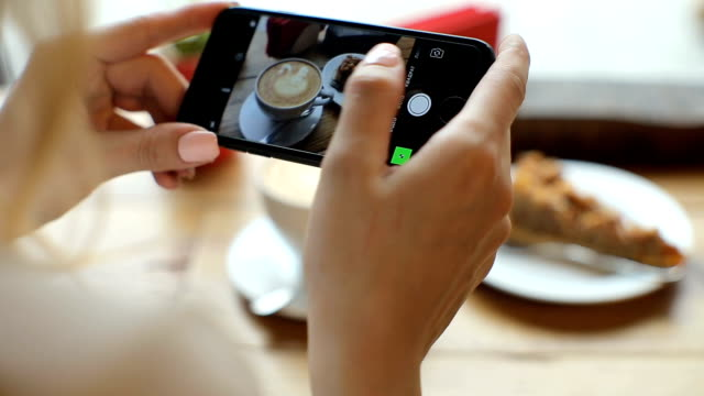 Attractive young woman Photographing food in coffee shop. closus-up - Vidéo