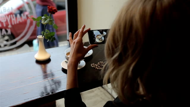 Attractive young woman Photographing food in restuarant cafe video