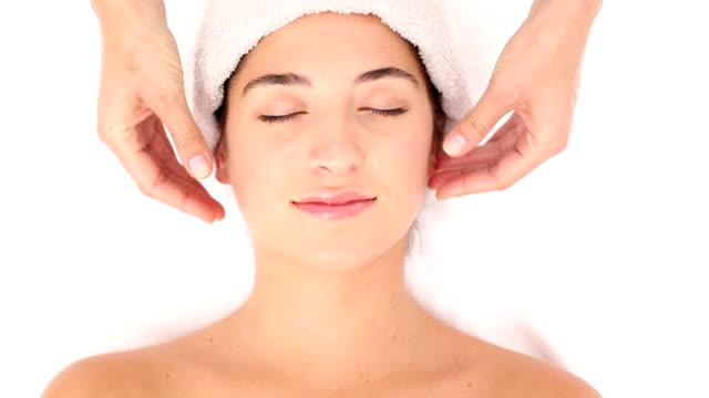 Attractive young woman receiving head massage at spa center Attractive young woman receiving head massage at spa center in slow motion spa treatment stock videos & royalty-free footage