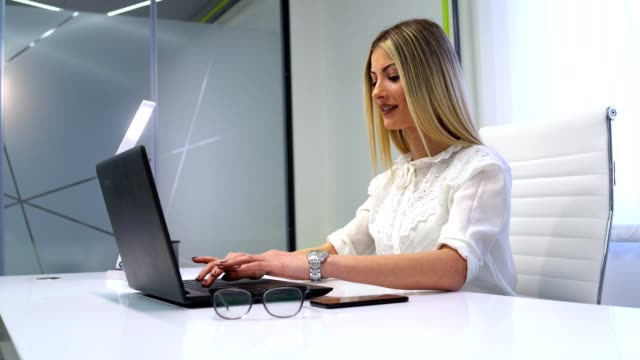 attractive young women working on a laptop in her office - miroslav mitic stock videos and b-roll footage
