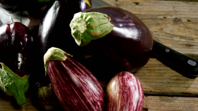 Aubergines on a chopping board 4k video