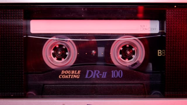 audio cassette in the player. close-up - hip hop video stock e b–roll